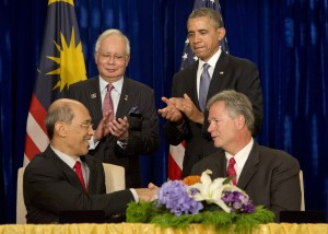 President Barack Obama, standing right, and Malaysian Prime Minister Najib Razak, standing left, applaud as Bill Radany, President & CEO, Verdezyne, right, and  Tan Sri Dato' Seri Mohd Bakke Salleh, President & Group Chief Executive, Sime Darby Berhad, left, participate in the signing of major commercial agreements with American businesses at the Ritz-Carlton in Kuala Lumpur, Malaysia, Monday, April 28, 2014. (AP Photo/Carolyn Kaster)